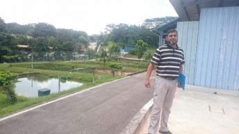 <p>Mohammed at the fish farms in Singapore. </p>